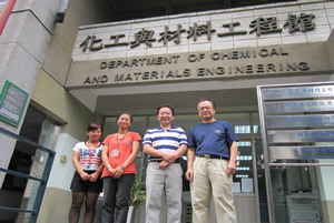 Group photo before the logo of Department of Chemical and Materials Engineering